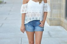 With denim shorts and brown flat sandals