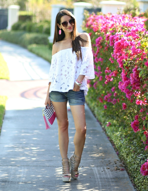With denim shorts, striped clutch and gray sandals