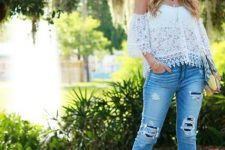 With distressed cropped jeans and brown shoes