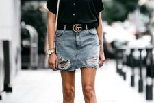 With distressed denim mini skirt, black belt, black ankle strap shoes and white bag
