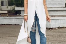 With distresssed skinny jeans, transparent sandals and beige chain strap bag