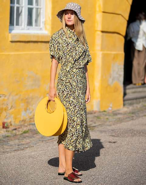 With floral midi dress, yellow rounded bag and marsala flat sandals