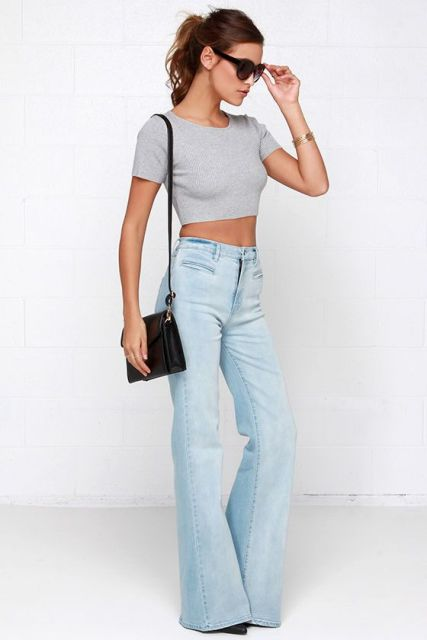 With gray crop top, black bag and black pumps