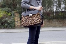 With gray sweatshirt, skinny jeans and leopard printed bag