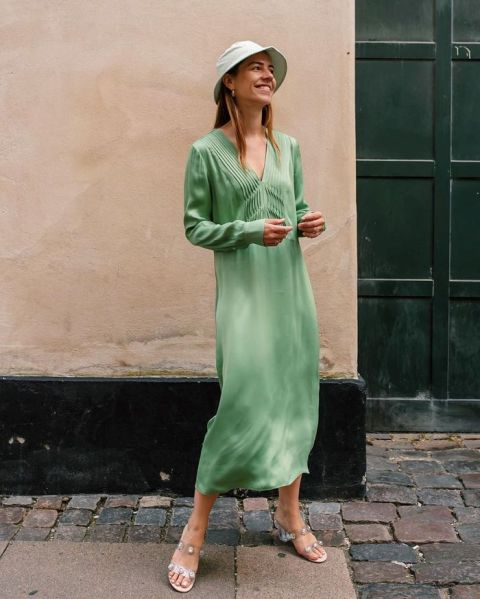 With green midi dress and embellished sandals