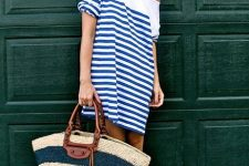 With hat and striped one shoulder dress
