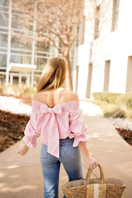 With high waisted flare jeans and straw bag