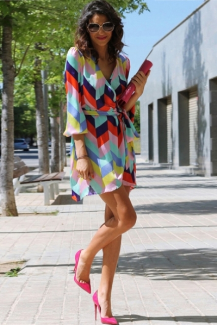 With hot pink pumps and leather clutch