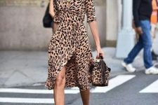 With leopard printed wrap midi dress and leopard printed bag