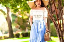 With light blue ruffled wrap skirt, straw bag, lace up sandals and hat