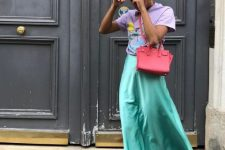 With lilac t-shirt, green skirt, red bag and lilac shoes