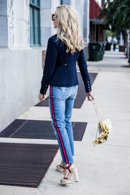With navy blue blazer, bag and high heels