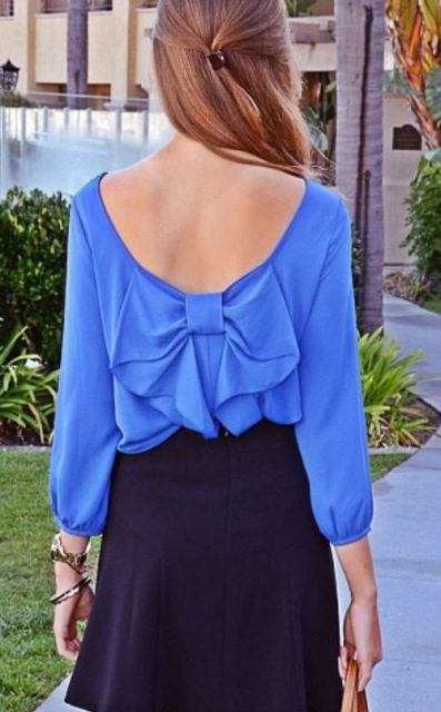 With navy blue mini skirt and brown bag