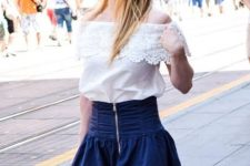 With navy blue mini skirt and brown tote bag