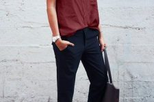 With navy blue trousers, tote bag and pale pink embellished shoes