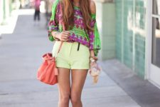 With one shoulder blouse, shorts and pink bag