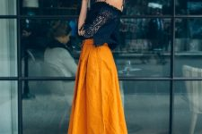 With orange midi skirt and heeled mules