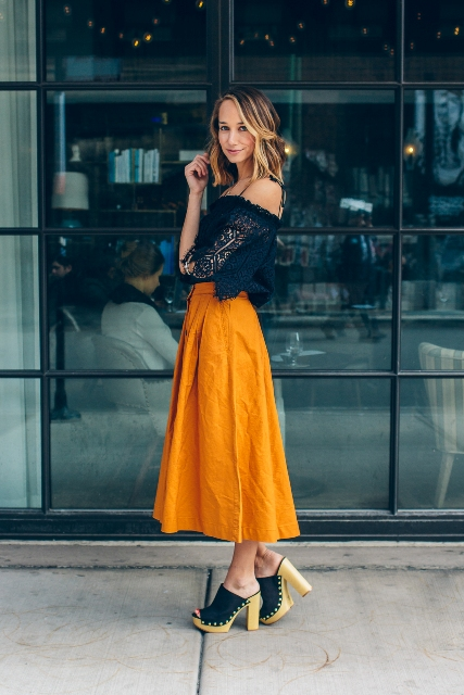With orange midi skirt and heeled mules