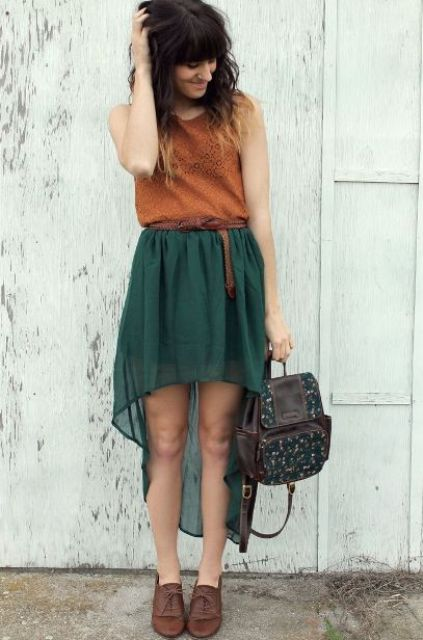 With orange top, emerald high low skirt and brown shoes