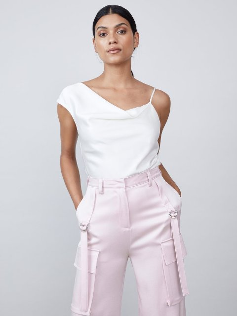 With pale pink trousers
