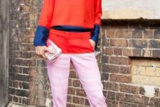 With pink, orange and blue shirt, clutch and black high heels