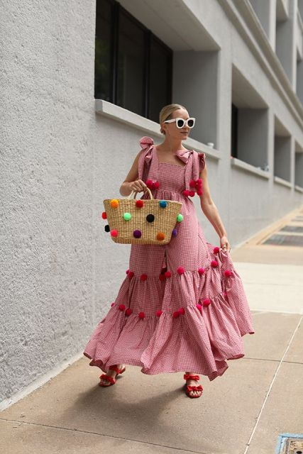 With pink pom pom maxi dress and red flat sandals