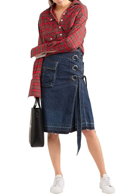 With plaid button down shirt, black tote bag and white sneakers