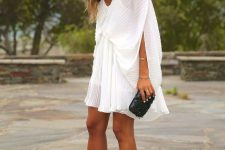 With pleated mini dress and black clutch