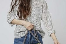 With polka dot button down shirt and jeans