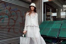 With printed maxi dress, bag and sneakers