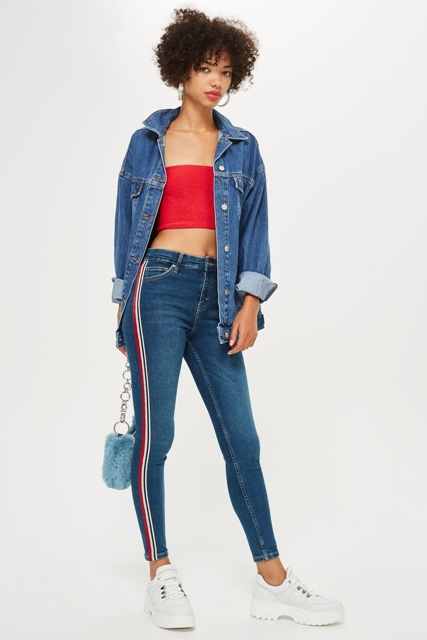 With red crop top, denim shirt, light blue bag and white shoes