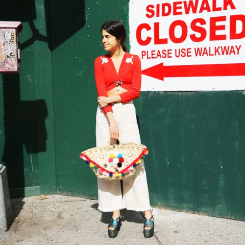 With red crop top, white palazzo pants and platform sandals