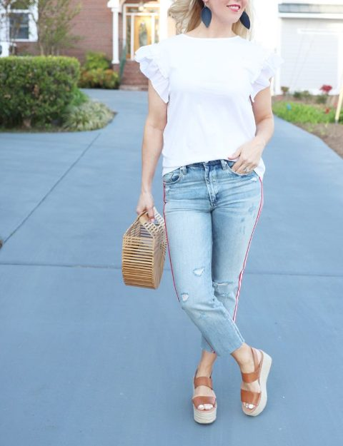 With ruffled blouse, straw bag and brown platform sandals