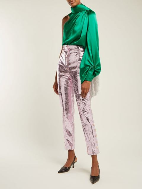 With silver metallic cropped pants and black low heeled shoes