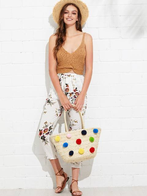 With sleeveless top, hat, floral pants and lace up sandals