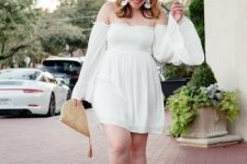 With straw clutch and light blue pumps