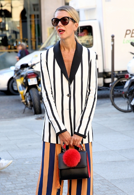 With striped blazer and striped loose trousers