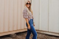 With striped blouse and oversized sunglasses