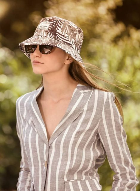 With striped linen blazer and jeans