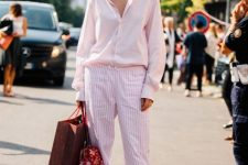 With striped pants, printed bag, white shoes and pale pink button down shirt