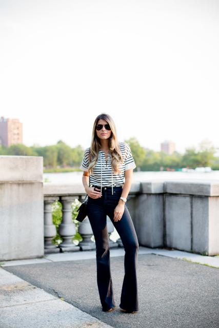 With striped shirt and black bag