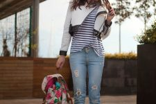 With striped shirt, white and black crop jacket, cuffed jeans and sneakers