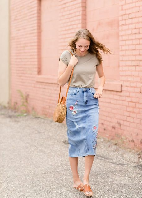 With t-shirt, straw rounded bag and brown flat sandals