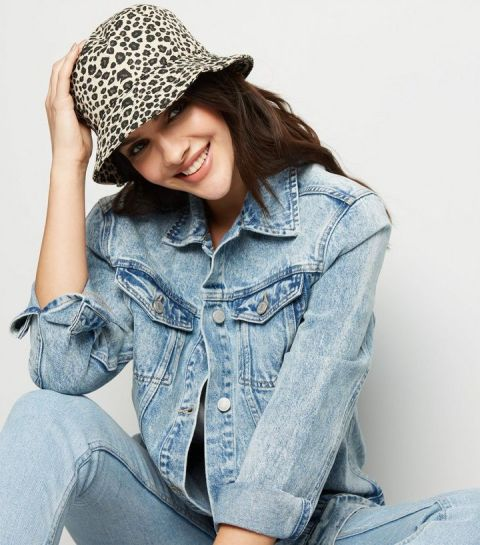 With top, denim jacket and jeans