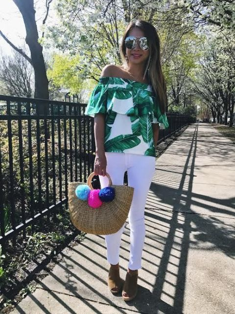 With tropical printed top, white skinny pants and cutout shoes