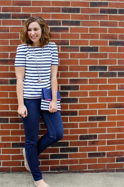With white and black striped shirt, jeans and beige flats