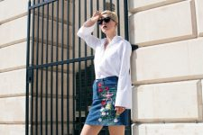 With white bell sleeved blouse and white flat shoes