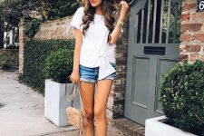 With white blouse, beige tassel bag and denim shorts