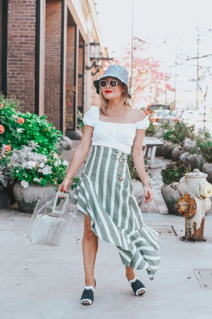With white blouse, transparent bag, striped ruffled skirt and mules