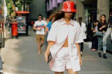 With white button down shirt, white shorts and clutch